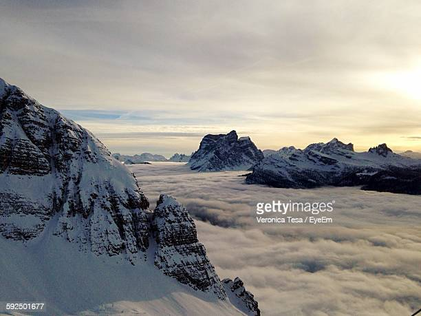 Scenic View Of Rock Formations With Clouds During Winter