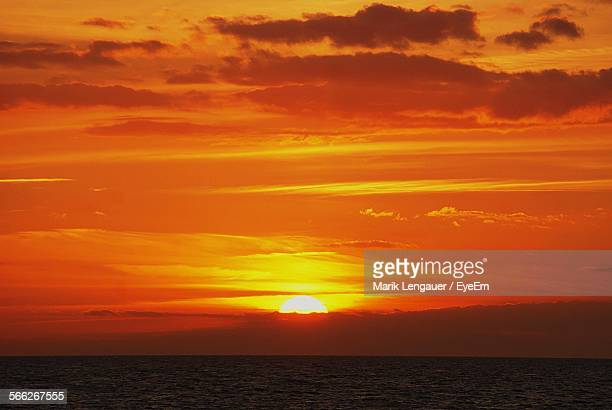 Scenic View Of Romantic Sunset Sky Over Sea