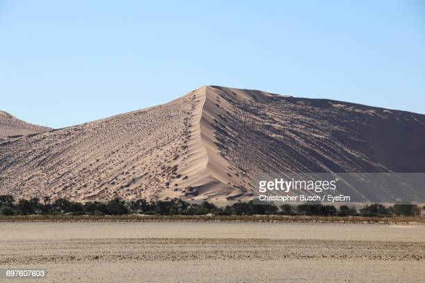 Scenic View Of Sand Against Clear Sky