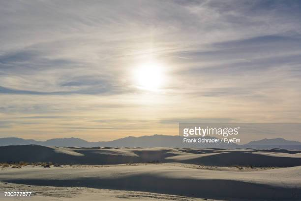 Scenic View Of Sand Dunes During Sunset