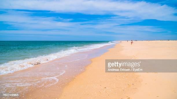Scenic View Of Sea Against Blue Sky During Sunny Day