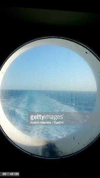 Scenic View Of Sea Against Clear Blue Sky Seen Through Ship Window