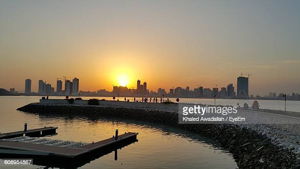 Scenic View Of Sea Against Clear Sky In City During Sunset