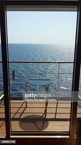 Scenic View Of Sea Against Clear Sky Seen From Glass Door In Cruise Ship