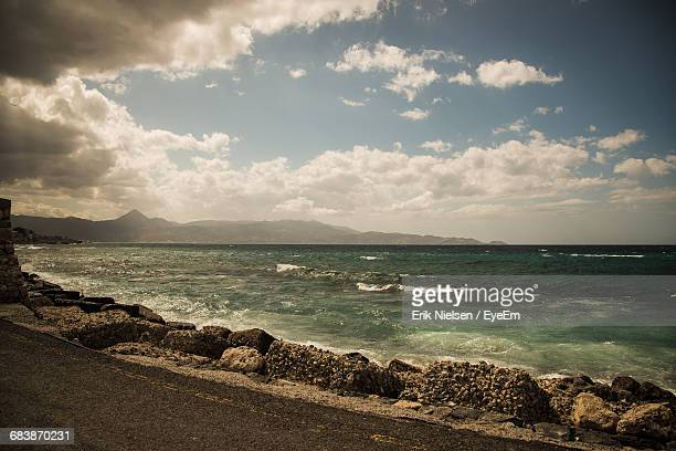 Scenic View Of Sea Against Cloudy Sky During Sunny Day