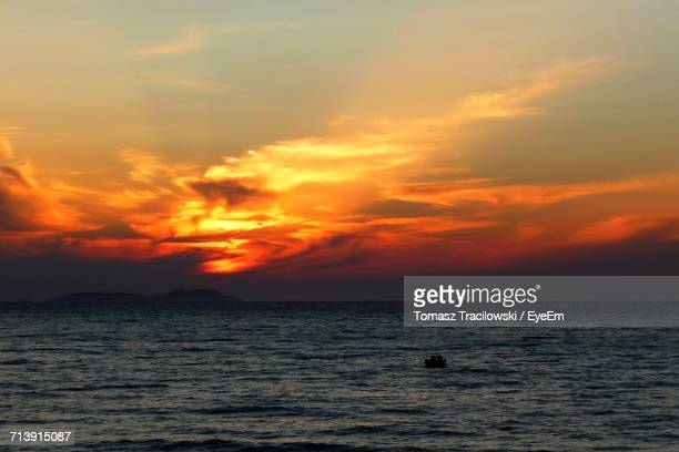 Scenic View Of Sea Against Dramatic Sky During Sunset