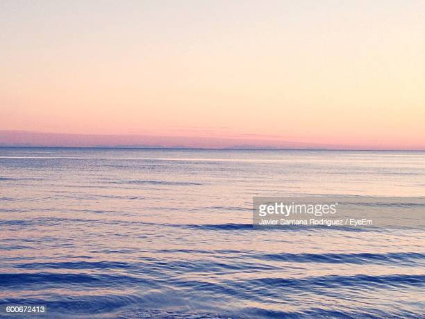 Scenic View Of Sea Against Sky At Sunrise