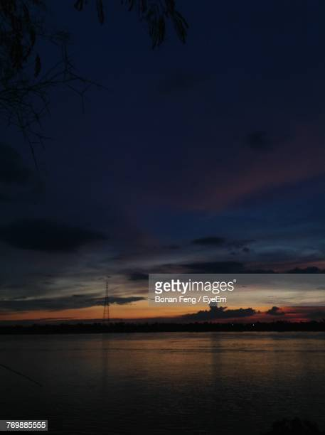 Scenic View Of Sea Against Sky At Sunset