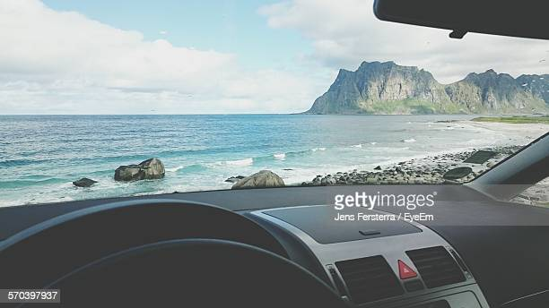 Scenic View Of Sea Against Sky Seem From Car Windshield