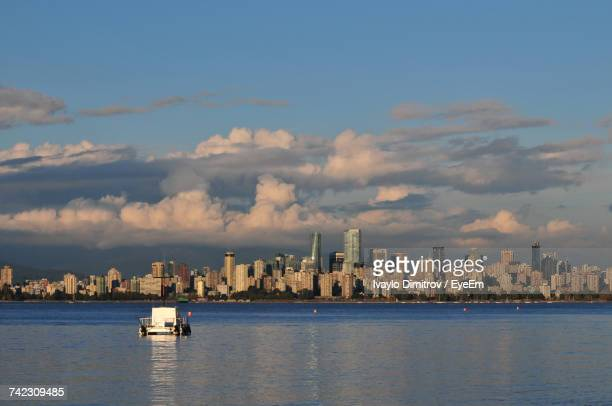 Scenic View Of Sea And Cityscape Against Sky