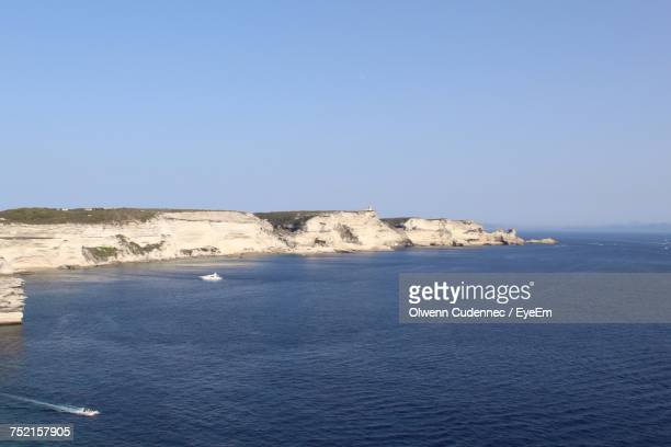 Scenic View Of Sea And Cliff Against Clear Sky