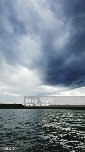 Scenic View Of Sea And Cloudy Sky