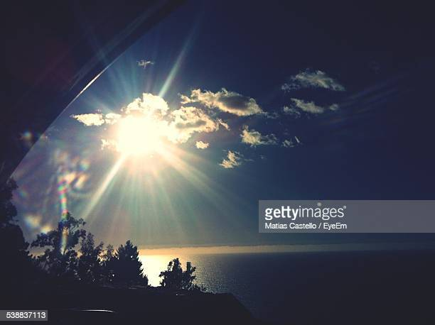 Scenic View Of Sea During Sunset Seen Through Car Window