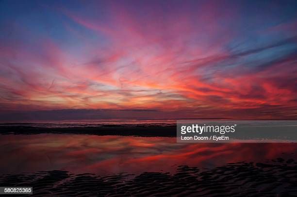 Scenic View Of Sea With Romantic Sky Reflection At Sunset