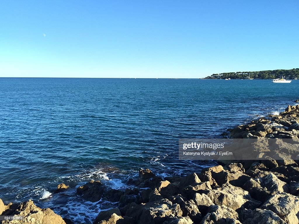Scenic View Of Seascape Against Clear Blue Sky