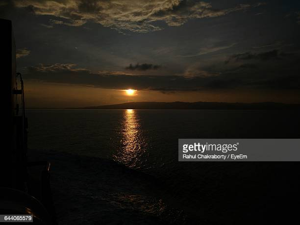 Scenic View Of Seascape Against Sky At Sunset