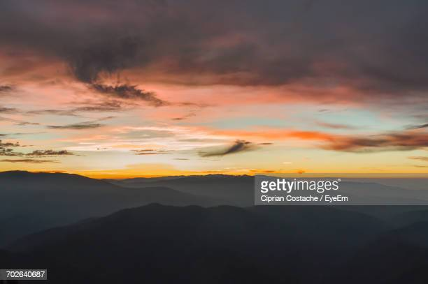 Scenic View Of Silhouette Mountain Range Against Dramatic Sky