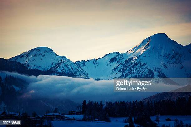 Scenic View Of Snow Covered Mountains At Dusk