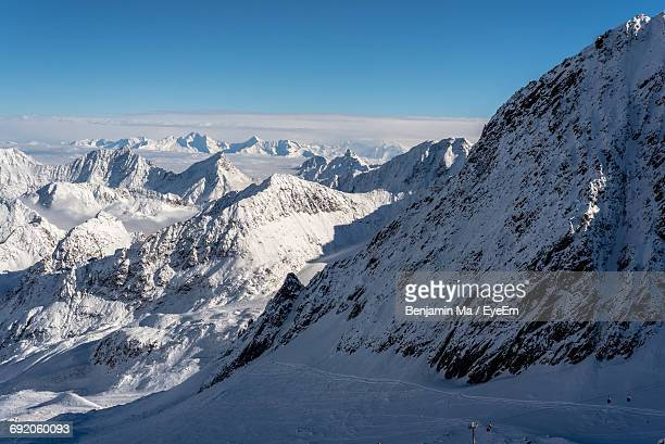 Scenic View Of Snowcapped Alps Against Blue Sky