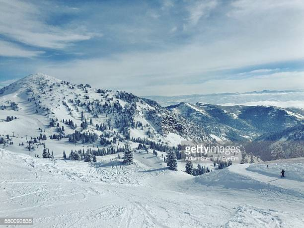 Scenic View Of Snowcapped Landscape Against Cloudy Sky