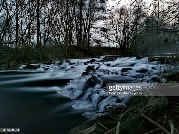 Scenic View Of Stream In Winter