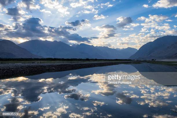 Scenic view of sunrise over lake with reflections at Nubra valley Ladakh, India