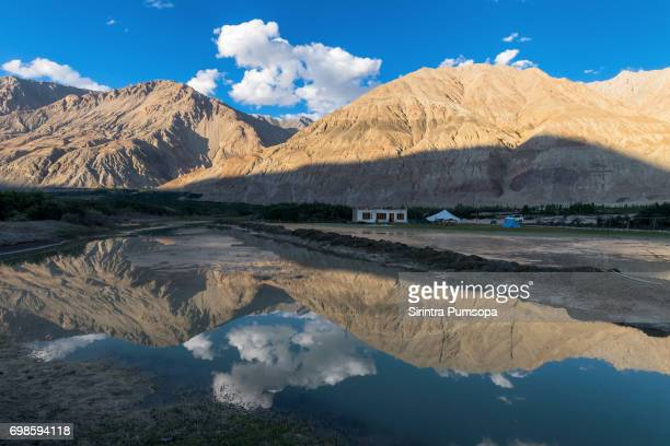 Scenic view of sunset over lake with reflections at Nubra valley Ladakh, India