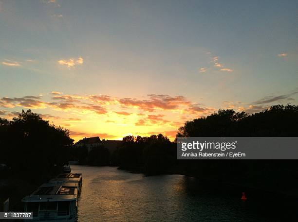 Scenic view of sunset over landscape with river