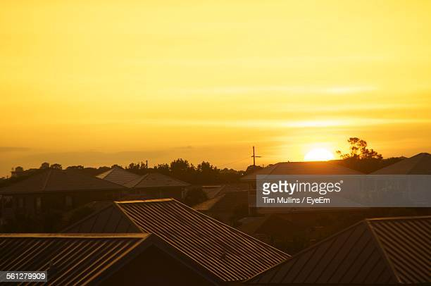 Scenic View Of Sunset Over Rooftops