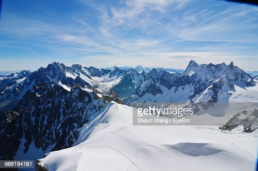 Scenic view of Swiss Alps covered with snow against sky