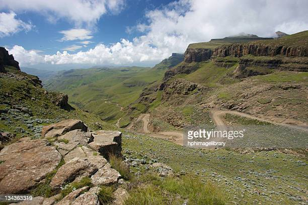 A scenic view of the a trail through the hills of the Sani Pass, Drakensberg Park, KwaZulu-Natal, South Africa