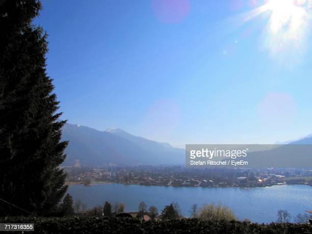 Scenic View Of Town By Mountains Against Clear Sky