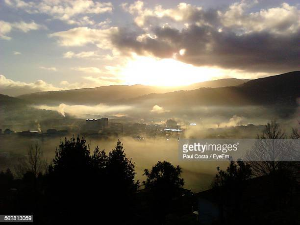 Scenic View Of Town During Sunrise