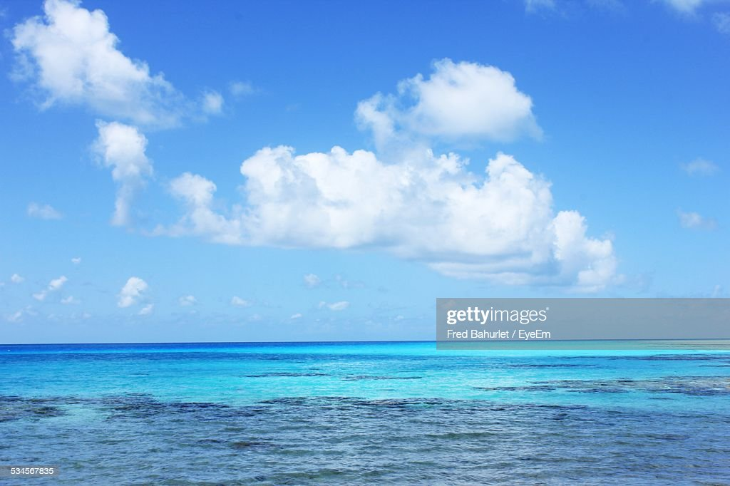 Scenic View Of Turquoise Sea Against Sky : Stock Photo