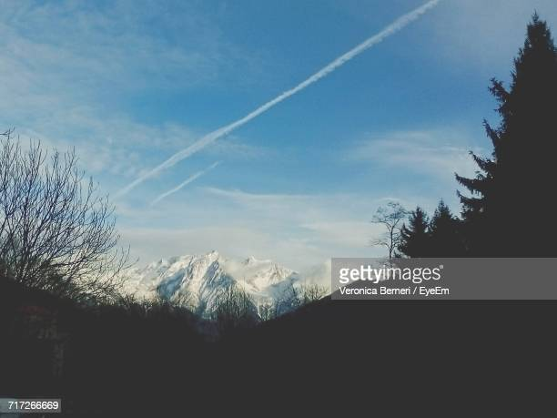 Scenic View Of Vapor Trail Against Sky During Winter