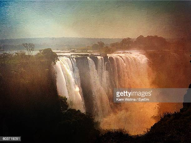Scenic View Of Victoria Falls Against Sky During Sunset
