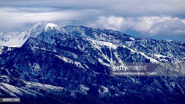 Scenic View Of Wasatch Mountains Against Cloudy Sky