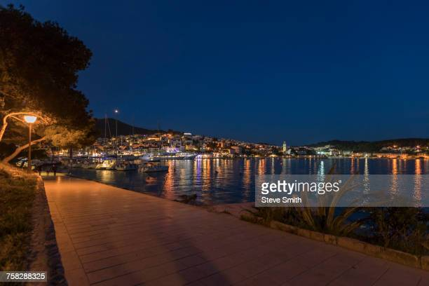 Scenic view of waterfront at night