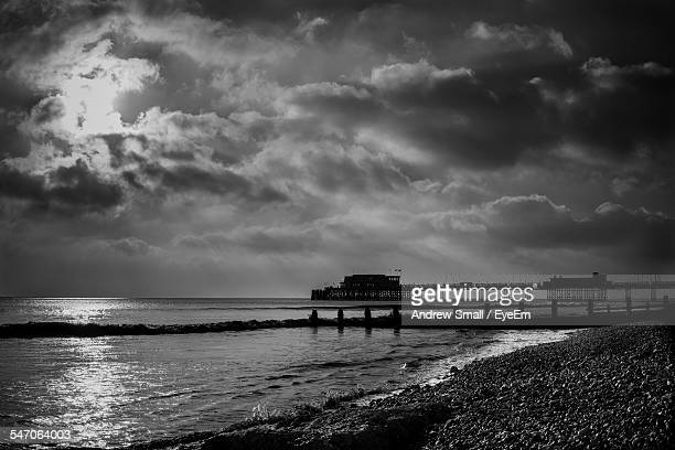 Scenic View Of Worthing Beach Against Cloudy Sky At Dusk