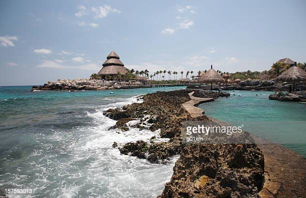 A scenic view of Xcaret with rocks and ocean