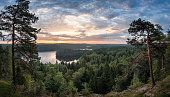 Scenic view with lake and sunset at summer morning in National Park Aulanko, Hämeenlinna, Finland