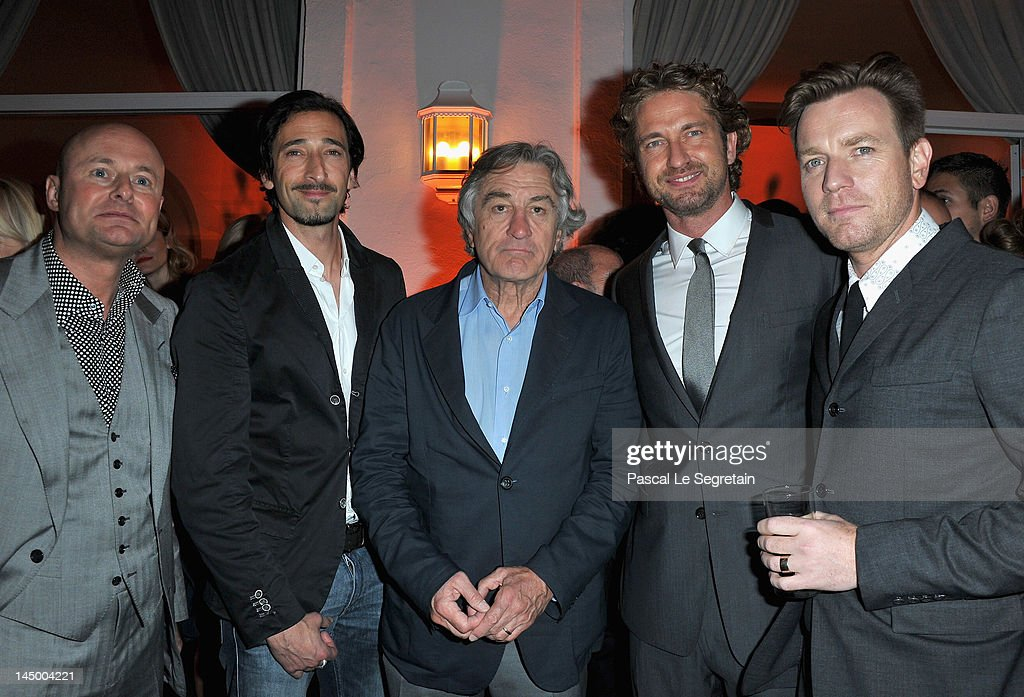 IWC Schaffhausen CEO Georges Kern, Actor <a gi-track='captionPersonalityLinkClicked' href=/galleries/search?phrase=Adrien+Brody&family=editorial&specificpeople=202175 ng-click='$event.stopPropagation()'>Adrien Brody</a>, co-founder of the Tribeca Film Festival <a gi-track='captionPersonalityLinkClicked' href=/galleries/search?phrase=Robert+De+Niro&family=editorial&specificpeople=201673 ng-click='$event.stopPropagation()'>Robert De Niro</a>, actors <a gi-track='captionPersonalityLinkClicked' href=/galleries/search?phrase=Gerard+Butler+-+Actor&family=editorial&specificpeople=202258 ng-click='$event.stopPropagation()'>Gerard Butler</a> and Ewan McGrego attend the exclusive Filmmakers Dinner during the Cannes International Film Festival hosted by Swiss watch manufacturer IWC Schaffhausen in partnership with Finch's Quarterly Review at the famous Hotel du Cap-Eden-Roc on May 21, 2012 in Cap d'Antibes, France.