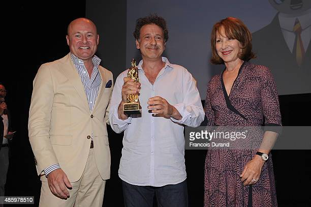 Schaffhausen CEO Georges Kern winner of the best screen writer Emmanuel Finkiel and Nathalie Baye on stage during the 8th Angouleme FrenchSpeaking...
