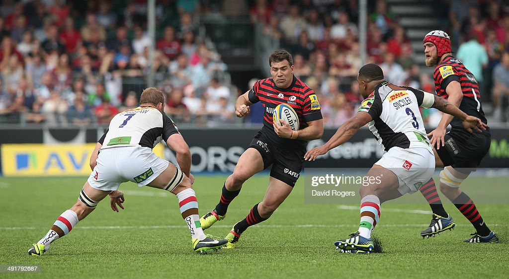 <a gi-track='captionPersonalityLinkClicked' href=/galleries/search?phrase=Schalk+Brits&family=editorial&specificpeople=686630 ng-click='$event.stopPropagation()'>Schalk Brits</a> of Saracens is tackled by <a gi-track='captionPersonalityLinkClicked' href=/galleries/search?phrase=Chris+Robshaw&family=editorial&specificpeople=2375303 ng-click='$event.stopPropagation()'>Chris Robshaw</a> (L) and Kyle Sinckler during the Aviva Premiership semi final match between Saracens and Harlequins at Allianz Park on May 17, 2014 in Barnet, England.