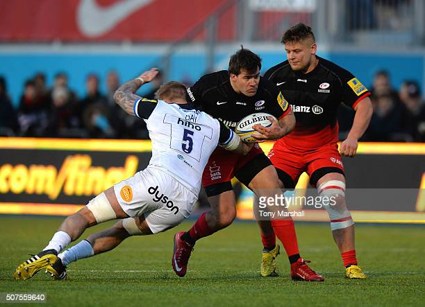 Schalk Brits of Saracens is tackled by Dominic Day of Bath Rugby during the Aviva Premiership match between Saracens and Bath Rugby at Allianz Park...