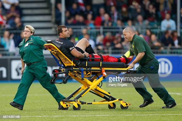 Schalk Brits of Saracens is taken off the pitch on a stretcher during the European Rugby Champions Cup pool one match between Saracens and ASM...