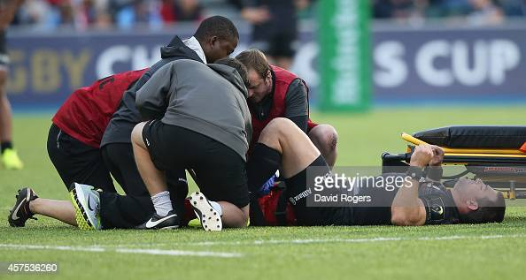 Schalk Brits of Saracens receives attention to a knee injury during the European Rugby Champions Cup match between Saracens and ASM Clermont Auvergne...