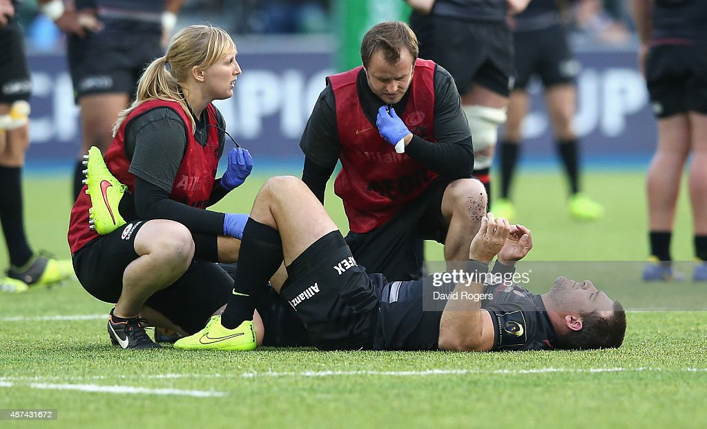 Schalk Brits of Saracens receives attention to an ankle injury during the European Rugby Champions Cup match between Saracens and ASM Clermont...