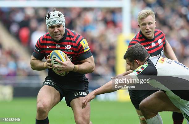 Schalk Brits of Saracens runs with the ball during the Aviva Premiership match between Saracens and Harlequins at Wembley Stadium on March 22 2014 in...