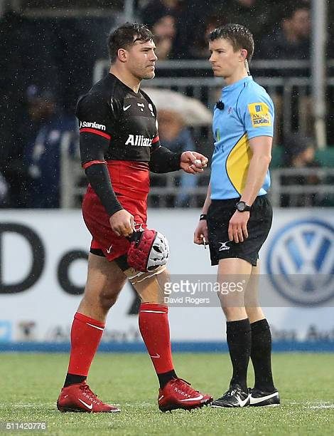 Schalk Brits of Saracens walks past referee Craig MaxwellKeys after being sent off for punching Nick Wood during the Aviva Premiership match between...